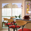 Kitchen solar shades with red barstools